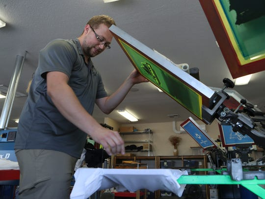 Boundary Waters Screenprinting manager Trevor Karns