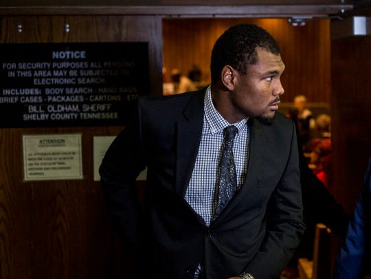 Ernest Suttles, a former University of Memphis defensive lineman charged with rape, leaves the courtroom after entering a plea of not guilty last month.