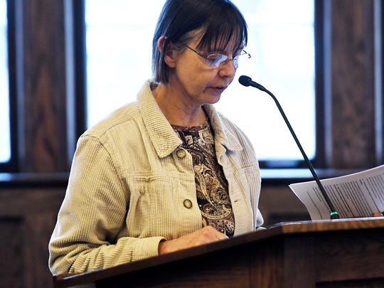 Lansing Environmental Action Team's Becky Payne voices her opposition to the proposed $500 million natural gas power plant during a commissioners meeting at the Board of Water and Light REO Town Depot facility on Tuesday, March 27, 2018, in Lansing.