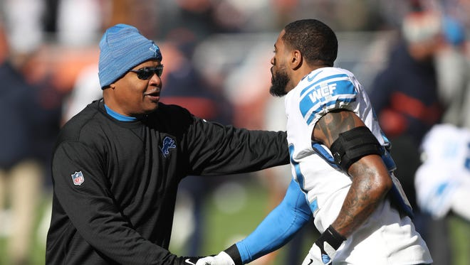 Lions coach Jim Caldwell shakes hands with safety Tavon Wilson before Sunday's game in Chicago.