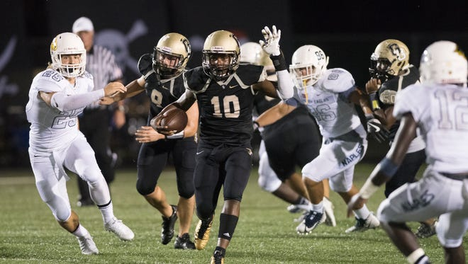 Jay Herard of Golden Gate runs with the ball during the game against Naples at Golden Gate High School Friday night, October 13, 2017.