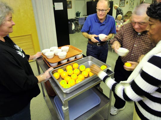 Senior grab meals during lunch Wednesday, Dec. 9, 2015 at Chambersburg Senior Center. Seniors are not seeing a cost of living increase in Social Security benefits in 2016.