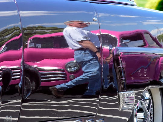 bob Strickland is reflected in a 1953 Ford Sedan at the Wyndham Garden York where registration for the 44th Annual Street Rod Nationals East took place Thursday, June 1, 2017. He brought his 1939 Dodge pick-up to the event. Bill Kalina photo