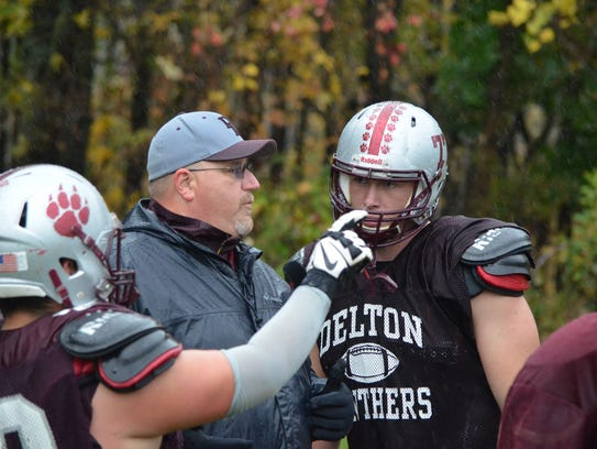 Delton Kellogg coach Ryan Bates with standout senior