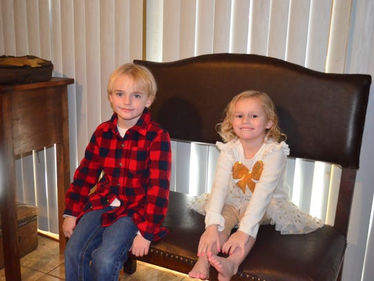 "Caleb ""Cob"" and Calli ""Wagon"" Agee sit on their father's"