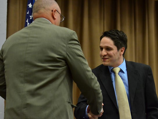 Daniel Carola is sworn in to the Hackensack Board of