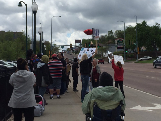 A group protests outside the Minnehaha County Courthouse before the bond hearing Wednesday for Mary Beth Jennewein, accused of killing her foster son.