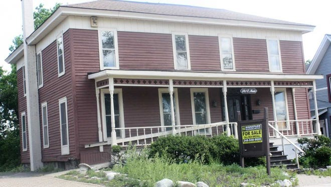A group of history-minded Northville residents is trying to stop the demolition of this century-old building.