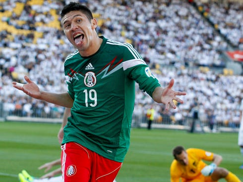 Mexico's Oribe Peralta celebrates a goal against New Zealand in their World Cup qualifying soccer match at Westpac Stadium in Wellington, New Zealand.