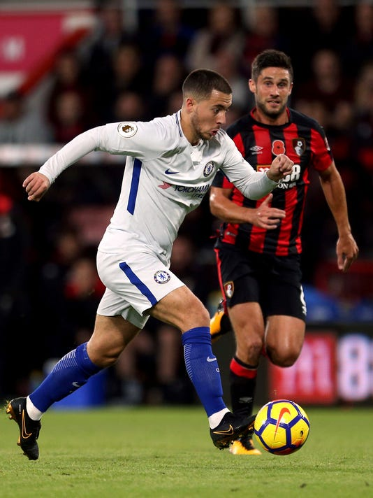 Chelsea's Eden Hazard, left, is chased by AFC Bournemouth's Andrew Surman during their English Premier League soccer match at the Vitality Stadium, Bournemouth, England, Saturday, Oct. 28, 2017. (Steven Paston/PA via AP)