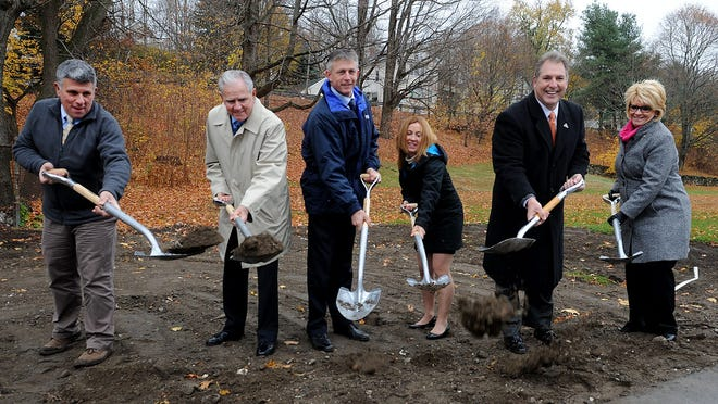 Public Works Commissioner John Ghiloni, left, is retiring next week after a nearly three-decade career in the city. Here he is pictured at the groundbreaking of the new senior center in 2013.