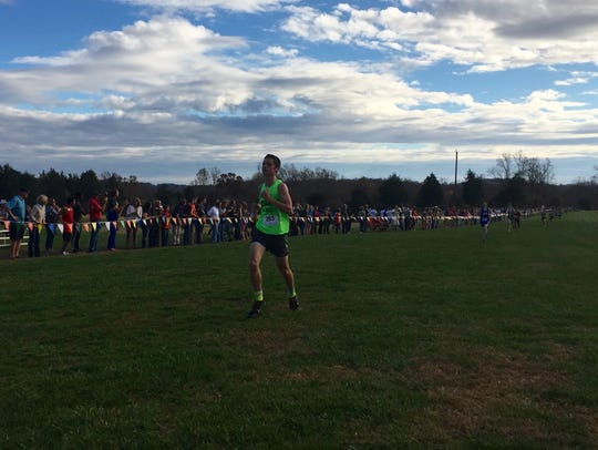 Wilson Memorial's Kyle Bryant finishes the boys race