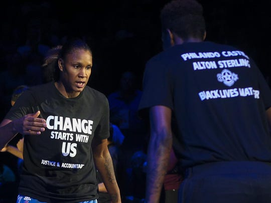 Minnesota Lynx forward Rebekkah Brunson, left, is greeted by Minnesota Lynx forward Natasha Howard while starting lineups are announced on July 9 at the Target Center in Minneapolis.