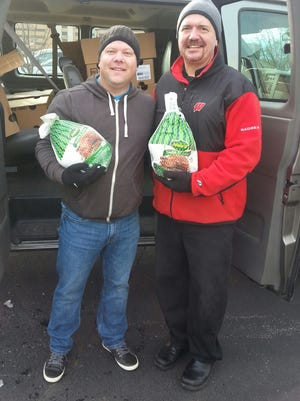 Rich Nimkie, right, Agnesian HealthCare head chef, is shown with turkey donations with the Rev. Tim Carlton, Lighthouse Christian Church's Food Pantry.