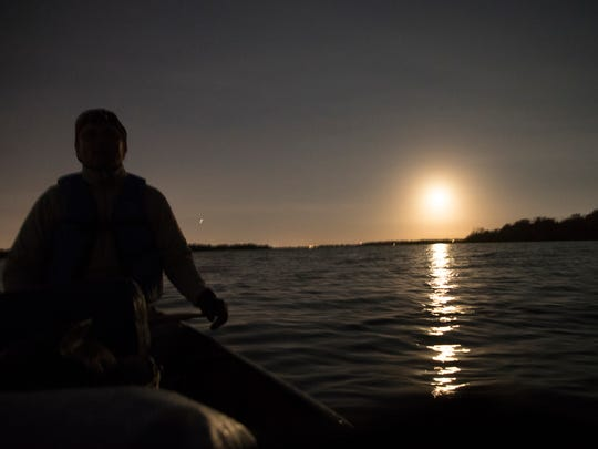 News-Press environmental reporter is shown in front of the supermoon in February on Lake Tohopekaliga.