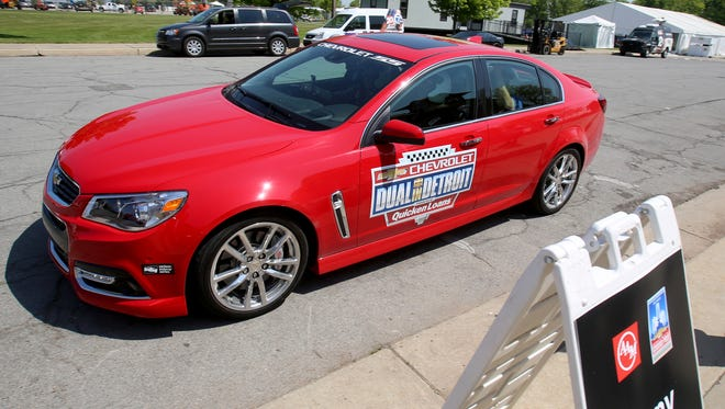 After being a passenger on a hot lap around the Detroit Grand Prix race course on Belle Isle, Detroit Free Press sports reporter Helene St. James riding in the passenger seat of a 2017 Chevrolet SS comes back to the pit area. Chevrolet hosted hot laps for members of the media at the race course on Tuesday, May 24, 2016.