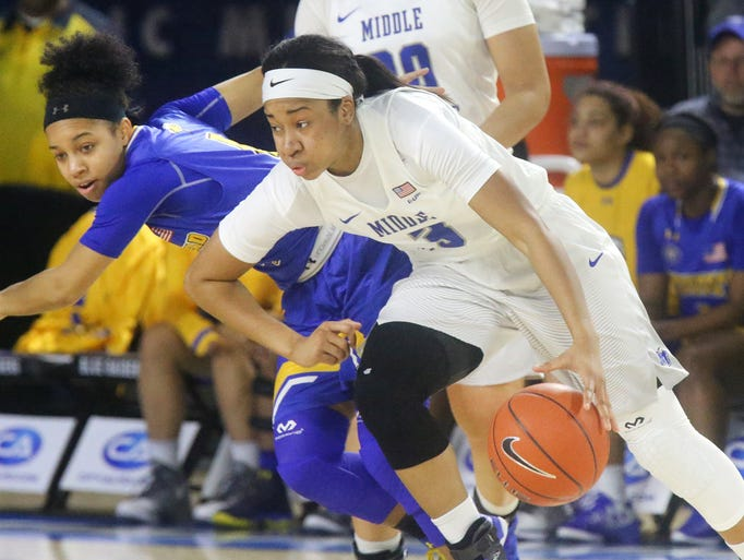 MTSU's Kyla Allison (3) pushes around Morrehead's Darianne