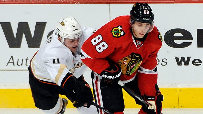 Chicago's Patrick Kane (88) is defended by Anaheim defenseman Cam Fowler. Both should be going to Sochi.