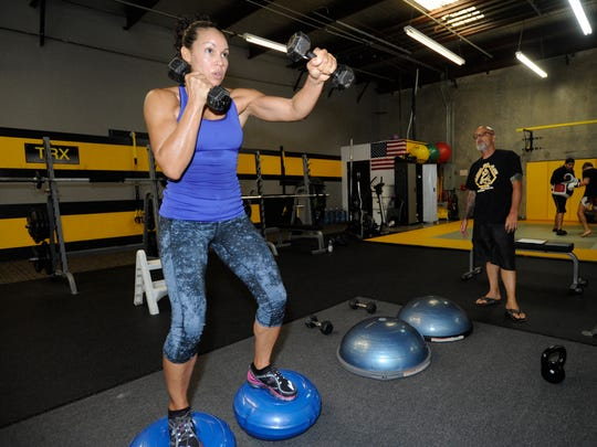 Marion Reneau works out on Tuesday at Elite Team Visalia Strength and Conditioning.
