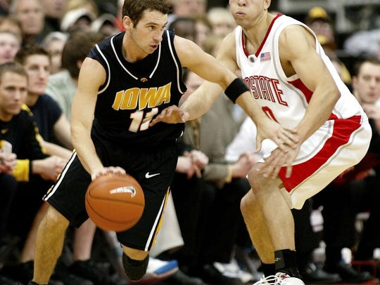 -  -Iowa's Brody Boyd (11) drives around Ohio State's