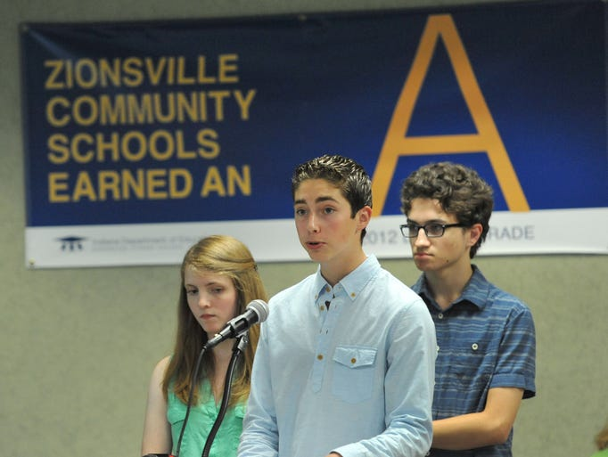 Zionsville High School students Anna Baker-Olson, a senior, left, and Spencer Bures, a sophomore, listen as senior Matt Noel address the Zionsville School Board regarding a proposed Random Drug Testing program, at a meeting at the Education Service Center Monday July 14, 2014.