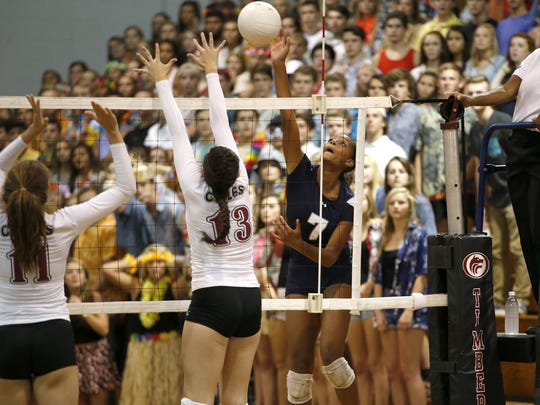 Maclay's Jewel Strawberry spikes the ball against Chiles'