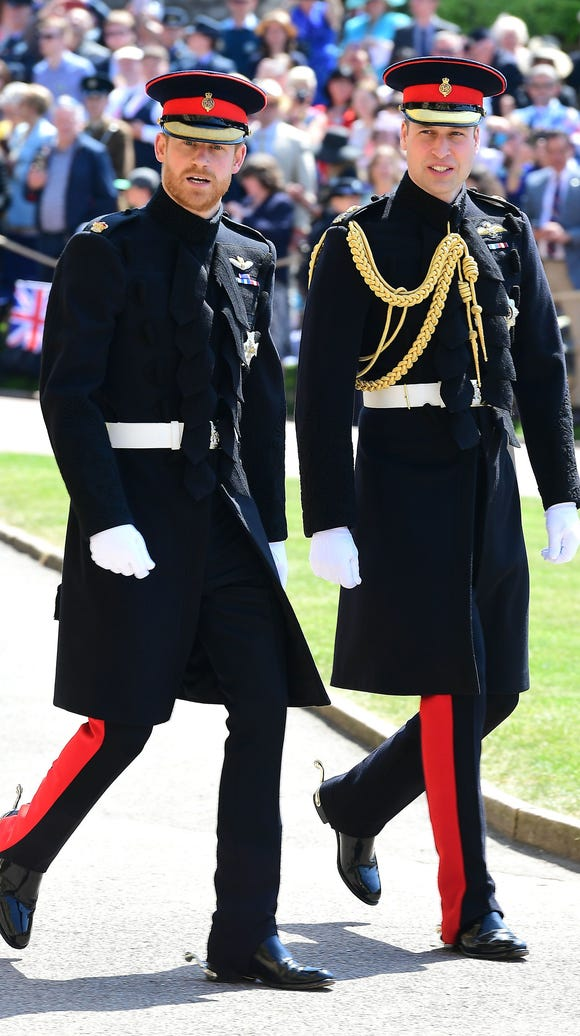 Hello, handsome! Prince Harry, left, opted for a (trimmed) version of his ginger beard for his wedding to Meghan Markle. His brother Prince William, Duke of Cambridge, served as best man.