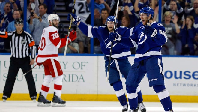 Braydon Coburn (55) of the Tampa Bay Lightning celebrates his goal with teammate Steven Stamkos (91) against the Detroit Red Wings in Game Seven of the Eastern Conference Quarterfinals during the 2015 NHL Stanley Cup Playoffs at Amalie Arena on April 29, 2015 in Tampa, Fla.