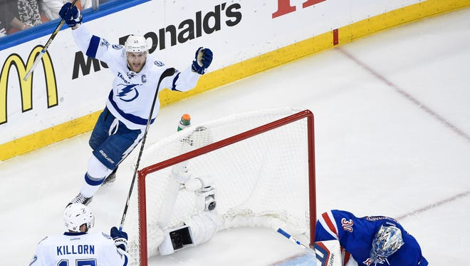 Steven Stamkos and Alex Killorn celebrate a goal against Rangers goalie Henrik Lundqvist during the second period.