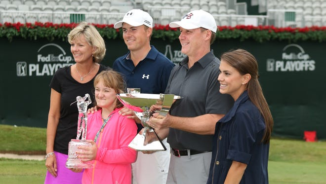 Jordan Spieth poses with his family and trophies after winning the final round of the Tour Championship by Coca-Cola at East Lake Golf Club.