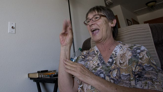 Peggy Sierra, who is hearing-impaired, uses sign language at Apache ASL Trails in Tempe. Federal programs that help people find safe housing they can afford will be chopped under the current $6 billion proposed cuts for HUD.