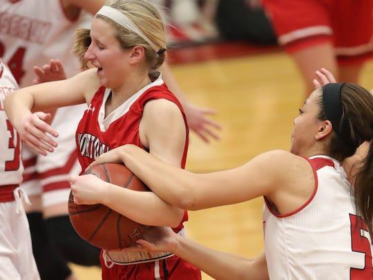 Kimberly High School's #5 Alina Hampton, right, against