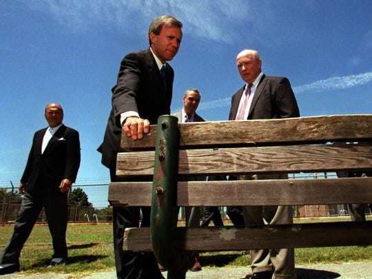 Mayor Bill Purcell, accompanied by Jim Fyke, Director of Parks and Recreation checks out a bench at East Community Center.