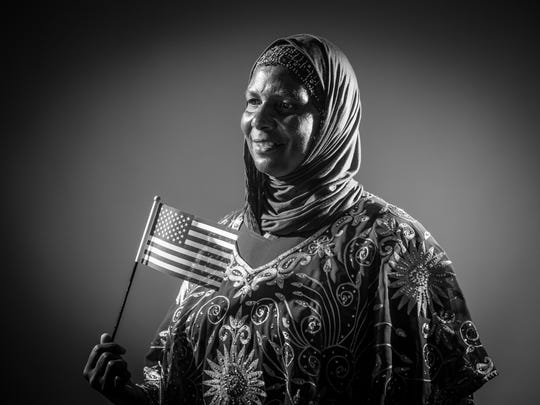 Ashd Mohamed, formerly a resident of Somalia, East Africa, poses for a portrait after Oath of Allegiance to become a naturalized citizen of the United States at Central Library on Tuesday, June 19, 2018.
