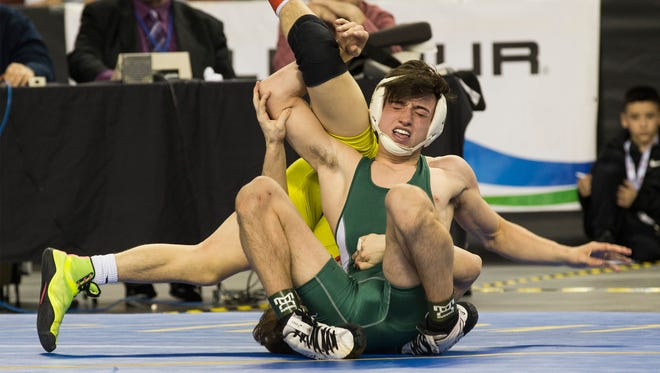 East Brunswick's Mitchell Polito vs Bergen Catholic's Robert Howard in 120 lbs. bout in NJSIAA State Wrestling Finals in Atlantic City on March 3, 2018.