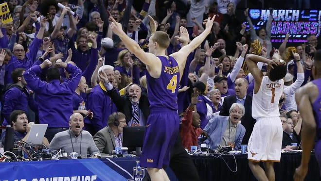 Northern Iowa guard and Merril native Paul Jesperson gestures to fans after hitting the game-winning shot against Texas in a first-round men's college basketball game in the NCAA Tournament, Friday in Oklahoma City.