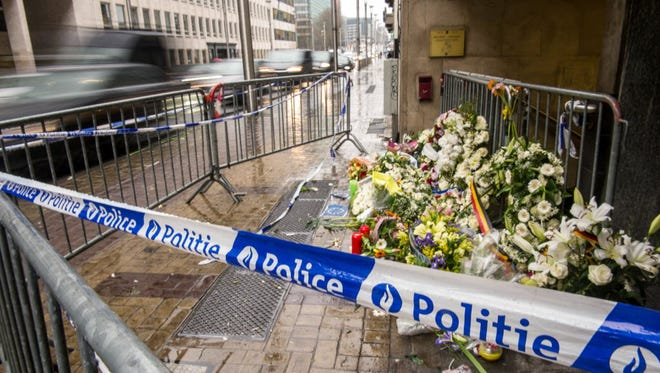 Wreaths of flowers are seen in front of an entrance of the Maalbeek subway station in Brussels in homage to the victims of a terrorist attack.