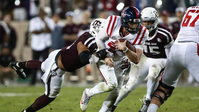 Mississippi quarterback Shea Patterson (20) carries the ball during the fourth quarter against Texas A&M.