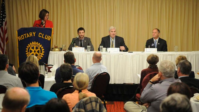 Sixth Congressional District candidates, from left to right, John Denney, Tom Emmer and Joe Perske take part in Tuesday's debate in St. Cloud. The debate was moderated by St. Cloud Area Chamber of Commerce President Teresa Bohnen.
