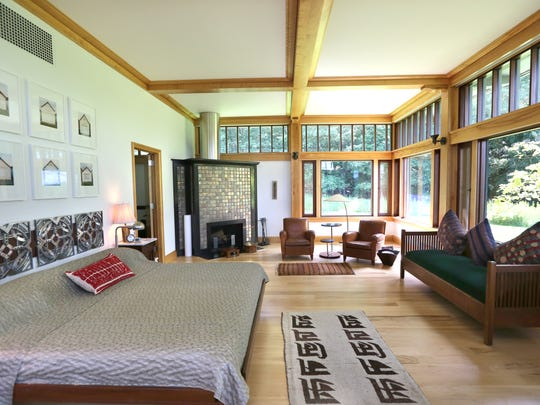 Master bedroom suite with pewabic tiled fireplace.