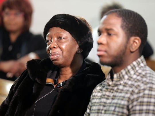 The mother of carjacking victim, Allison Tolson and her son Doug Tolson, 26, sit and listen to religious and community  leaders, as well as, friends of Anthony Tolson speak at Central Baptist Church in Detroit,  Monday, Dec. 28, 2015. He  was murdered during a carjacking on Christmas Eve near Gratiot and State Fair Avenue in Detroit.  Tolson attended this church and played the bass there. He was the father of three children and on the way to see them with Christmas presents after performing in church that night.