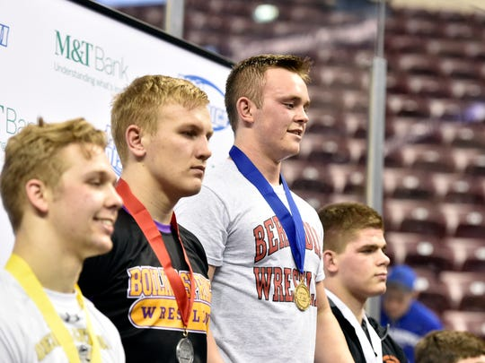 Bermudian Springs' Noah Fleshman stands on top of the podium for the medal ceremony after winning the District 3 Class 2A 195-pound championship match Saturday, Feb. 25, 2017, at the Giant Center in Hershey.