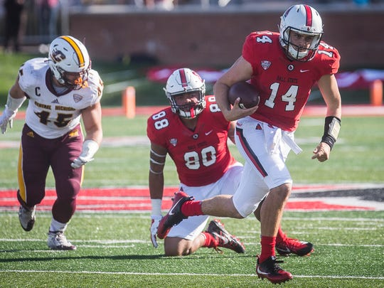 Ball State's Jack Milas runs against Central Michigan's defense during their game at Scheumann Stadium Saturday, Oct. 21, 2017.