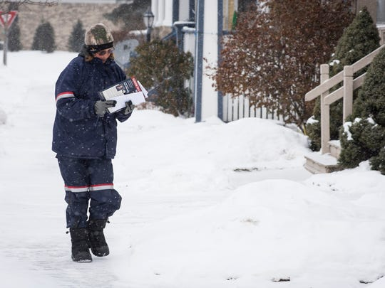 U.S. Postal Service employee Joanne Blackmer braves the cold temperatures to deliver mail in a neighborhood in Port Huron Jan. 3. The National Weather Service is predicting temperatures on Thursday to be as low as -6, with wind chills near -30.