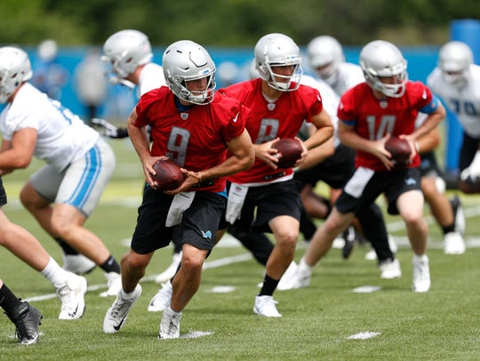 Detroit Lions quarterbacks Matthew Stafford (9), Matt