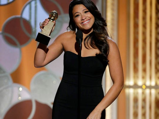 Gina Rodriguez poses with the award for best actress in a TV comedy.