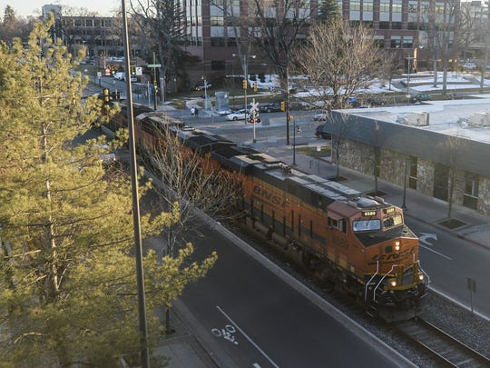 A train passes through Old Town Fort Collins on Mason Street in this 2015 file photo.