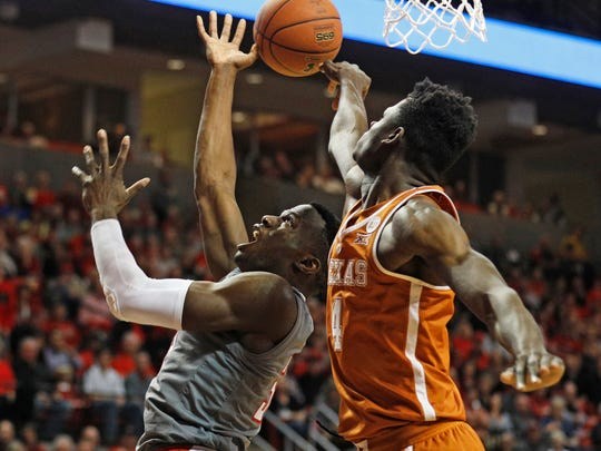 Texas' Mo Bamba (4) blocks the shot by Texas Tech's Norense Odiase (32) during the first half of an NCAA college basketball game Wednesday, Jan. 31, 2018, in Lubbock, Texas. (AP Photo/Brad Tollefson)