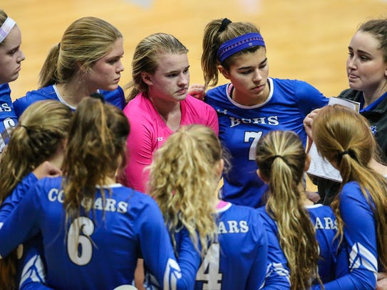 Barron Collier during a time-out in the Girls Volleyball