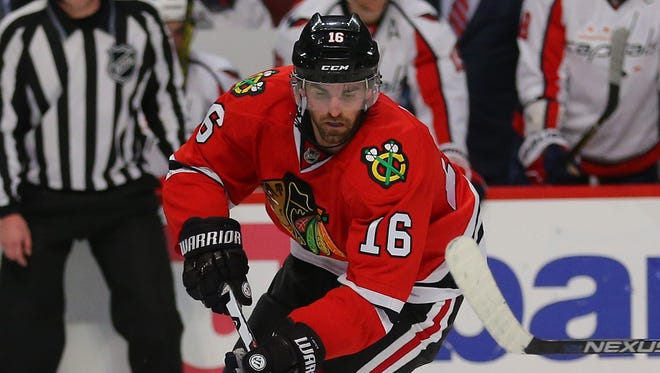 Andrew Ladd had an assist in his first game with the Blackhawks since being traded.